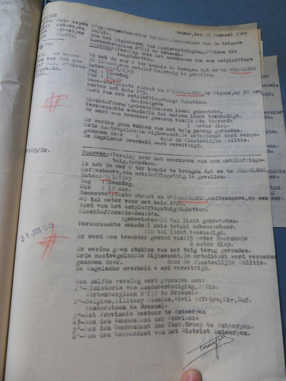 Het officiële, geheime verslag van de twee inslagen in Wommelgem die dag (in het Militair Archief van Evere).